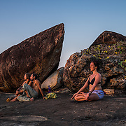 The rock formations at the south end of Agonda beach are a favorite place for people to watch the sunset.