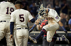 September 13, 2017 - Minneapolis, MN, USA - The Minnesota Twins' Eddie Rosario is greeted at home plate with a shower of bubble gum after he hit a walk-off two-run home run in the 10th inning against the San Diego Padres on Wednesday, Sept. 13, 2017, at Target Field in Minneapolis. The Twins won, 3-1, in 10 innings. (Credit Image: © Carlos Gonzalez/TNS via ZUMA Wire)