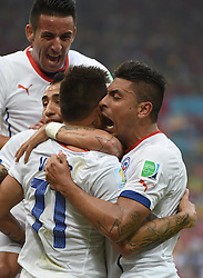 18-06-2014 BRA: World Cup Spanje - Chili, Rio Janeiro<br /> Chili wint met 2-0 van Spanje die door deze uitslag is  uitgeschakeld / Chile's Charles Aranguiz (L, front) celebrates for his goal with his teammates<br /> <br /> *** NETHERLANDS ONLY ***