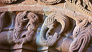 Norman Romanesque relief sculptures of dragons from the South doorway of Church of St Mary and St David, Kilpeck Herifordshire, England. Built around 1140 .<br /> <br /> Visit our MEDIEVAL PHOTO COLLECTIONS for more   photos  to download or buy as prints https://funkystock.photoshelter.com/gallery-collection/Medieval-Middle-Ages-Historic-Places-Arcaeological-Sites-Pictures-Images-of/C0000B5ZA54_WD0s