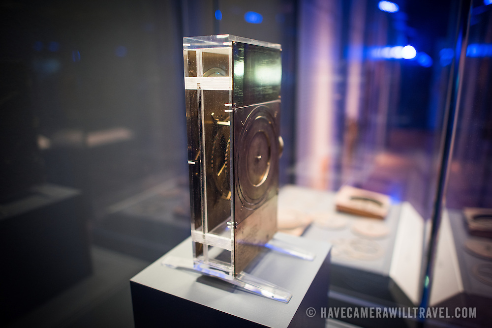 A 1970s reconstruction of the Antikythera Mechanism designed by Derek de Solla Price and constructed by R. Deroski. One of the highlights of the National Archaeological Museum in Athens, Greece, the Antikythera Mechanism now has its own dedicated exhibit gallery in which all of its fragments are on display. Believed to date to somewhere around 100 BC to 205 BC, it was found amongst a large cache of statues, coins, and other artefacts on a sunken shipwreck discovered in 1900 by sponge divers off the coast of the Greek island of Antikythera. It was badly damaged after such a long time in the salt water, but extensive research in recent decades has resulted in a consensus that it is a kind of astronomical analog computer as well as some modern reconstructions.