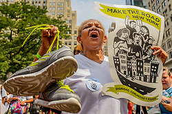 """August 2, 2017 - New York, New York, United States - On August 2, 2017; hundreds of immigrants and allies in New York City protested outside JPMorgan Chase offices, calling on its complicity in Trump's anti-immigrant agenda, partiularly through its financing of private immigrant detention centers run by the GEO Group and CoreCivic. The """"Taken From Us"""" protest featured powerful visual illustrations of the families separated by private immigrant detention centers, and thousands of empty pairs of shoes to symbolize relatives and friends detained in private immigration detention centers financed by JPMorgan Chase. (Credit Image: © Erik Mcgregor/Pacific Press via ZUMA Wire)"""