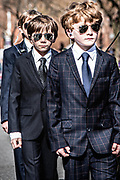 Kids in suits dressed as the President's secret service bodyguards walk at the President's parade on King's street in Alexandria, Virginia on 02/18/2019. Photo by Akash Pamarthy