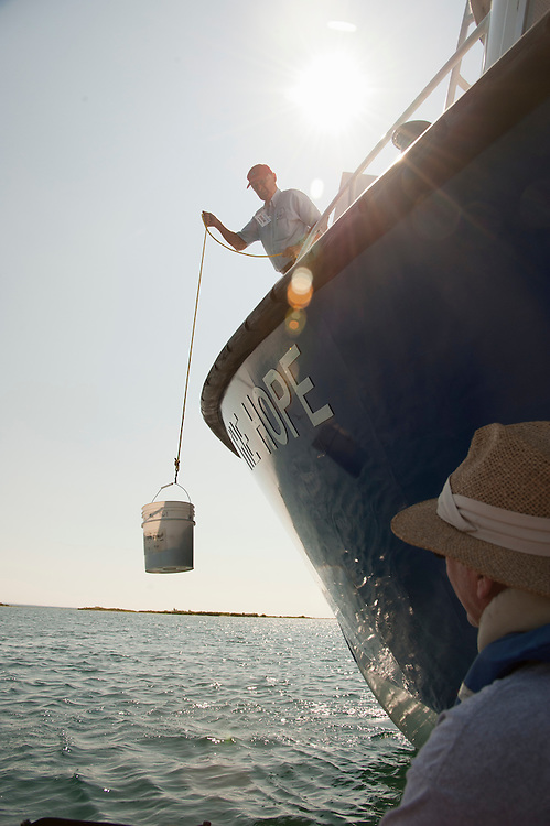 A Sheplers ferry delivers mail and other goods via a bucket drop to volunteers living on St. Helena Island on Lake Michigan.