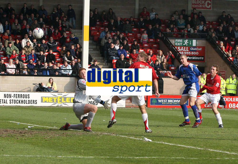 Photo: Mark Stephenson.<br />Walsall v Accrington Stanley. Coca Cola League 2. 31/03/2007. Walsall's Martin Butler chips the Accrington keeper David Martin for 3-2 and a win