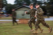 US Marines run at the command of a drill sergeant during bootcamp January 13, 2014 in Parris Island, SC.