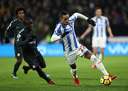 Chelsea's N'Golo Kante (left) and Huddersfield Town's Tom Ince battle for the ball