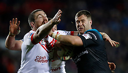 Leeds Rhinos' Trent Merrin is tackled by St Helens Saints' Kyle Amor during the Betfred Super League match at the Totally Wicked Stadium, St Helens.