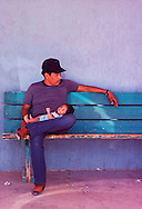 Father and Child sitting on Bench, Kayenta, Navajo Nation, Arizona