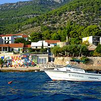 Konoba Miln Restaurant;<br />Coastline from the sea;<br />Bol, Brac, Croatia.