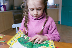 Little girl reading a picture book,