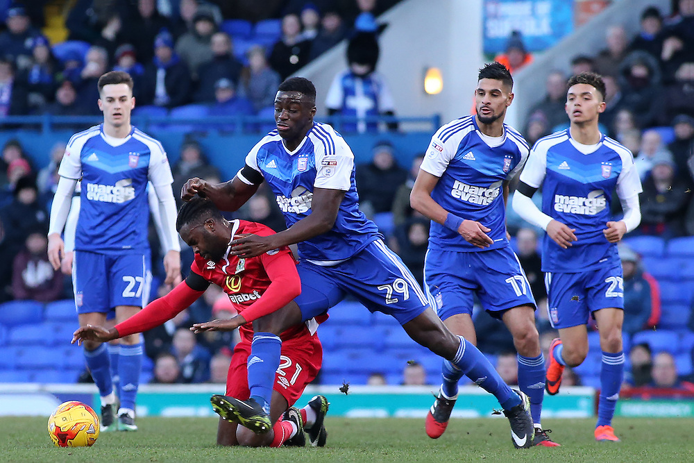 Blackburn Rovers' Hope Akpan is brought down by Ipswich Town's Josh Emmanuel<br /> <br /> Photographer David Shipman/CameraSport<br /> <br /> The EFL Sky Bet Championship - Ipswich Town v Blackburn Rovers - Saturday 14th January 2017 - Portman Road - Ipswich<br /> <br /> World Copyright © 2017 CameraSport. All rights reserved. 43 Linden Ave. Countesthorpe. Leicester. England. LE8 5PG - Tel: +44 (0) 116 277 4147 - admin@camerasport.com - www.camerasport.com