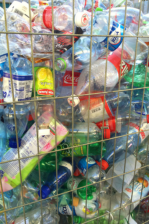 Viña del Mar, Valparaiso Region, Chile - Plastic bottles gathered for recycling in a street container.