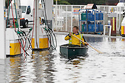 FLOODING HITE MORAYSHIRE , SCOTLAND ....  PIC IN ELGIN OF A MAN IN A CANOE GOING THROUGH THE FORECOURT OF A FLOODED PETROL STATION.PIC DEREK IRONSIDE / NEWSLINE SCOTLAND