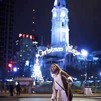 """Michael Grant, 28, """"Philly Jesus,"""" searches for a taxi in Philadelphia, PA on December 14, 2014.  Nearly everyday for the last 8 months, Grant has dressed as Jesus Christ, and walked the streets of Philadelphia to share the Christian gospel by example.  He quickly acquired the nickname of """"Philly Jesus,"""" which he has gone by ever since."""