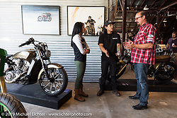 Karlee Cobb (Klock Werks), Aaron Guardado (Suicide Machine) and Brian Klock (Klock Werks) at the Friday night opening of the Handbuilt Motorcycle Show. Austin, TX. April 10, 2015.  Photography ©2015 Michael Lichter.