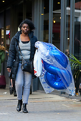 © Licensed to London News Pictures. 04/11/2020. London, UK. A woman carrying a bag full of balloons in north London on the eve of the second national lockdown, as all non-essential retailers will close from midnight tonight, for a month. This follows the announcement by the Prime Minister, Boris Johnson, of the lockdown in England from Thursday 5 November until Wednesday 2 December, to control the increase of coronavirus cases. Photo credit: Dinendra Haria/LNP