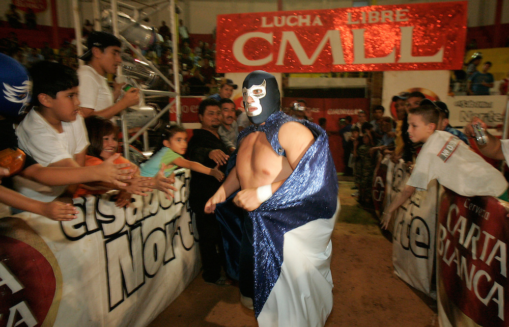 Blue Demon Jr. enters Reynosa's Plaza de Toros for the title card of a match in July.
