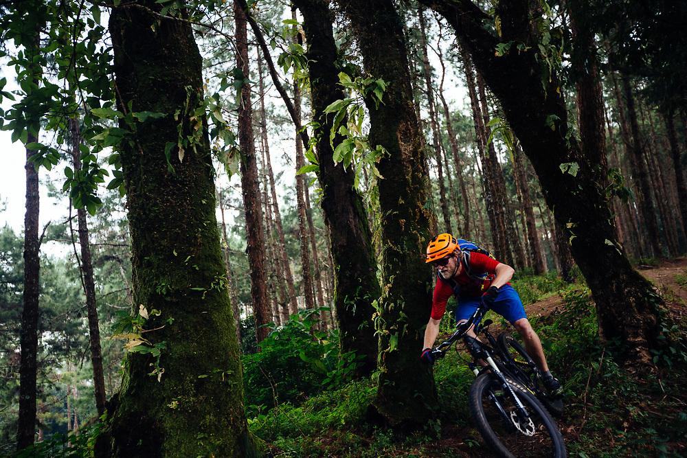 Andrew Whiteford rides the Doi Bakia Trail in the higher altitude jungle near Ban Sop Gai, Thailand.