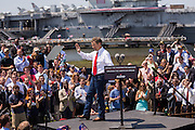 GOP presidential hopeful Senator Rand Paul waves to supporters following a campaign rally in front of the aircraft carrier USS Yorktown on April 9, 2015 in Mt Pleasant, South Carolina.  Paul outlined a foreign policy vision built both on a strong military and a commitment to use it sparingly.