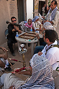 After the second of three mock battles of the day in the fabricated Iraqi village of Medina Wasl, built by set coordinators from Paramount Pictures at the National Training Center at Fort Irwin, California, Iraqis and Americans playing soldiers, victims, and insurgents relax together in the shade until the next 20 minutes of choreographed crisis. (From the book What I Eat: Around the World in 80 Diets.)