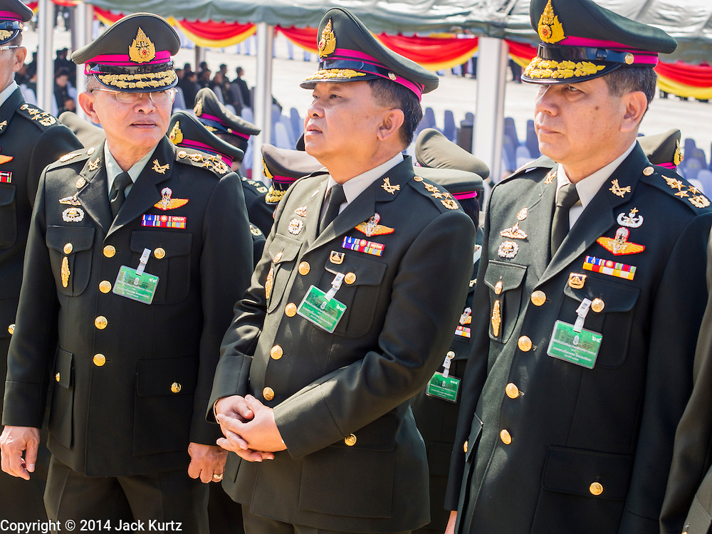 29 SEPTEMBER 2014 - NAKHON NAYOK, NAKHON NAYOK, THAILAND: Senior Thai generals walk into the retirement ceremony for more than 200 Thai generals including Gen. Prayuth Chan-ocha, who led the 22 May coup against the civilian government earlier this year. Prayuth has been chief of the Thai army since 2010. After his retirement, Gen. Prayuth will retain his posts as head of the junta's National Council for Peace and Order (NCPO) and Prime Minister of Thailand. Under Thai law, military officers must retire at 60 years of age. The 200 generals who retired with Prayuth were also his classmates at the Chulalomklao Royal Military Academy in Nakhon Nayok.    PHOTO BY JACK KURTZ