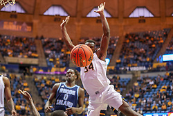 Dec 1, 2019; Morgantown, WV, USA; West Virginia Mountaineers forward Oscar Tshiebwe (34) looses a ball out of bounds during the second half against the Rhode Island Rams at WVU Coliseum. Mandatory Credit: Ben Queen-USA TODAY Sports