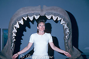 reconstructed jaws of extinct bigtooth shark, Carcharocles megalodon or Otodus megalodon ( extinct relative of great white shark ), with adult woman for scale; MR 304