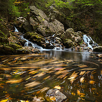 Autumn swirl at Bear's Den in New Salem, Massachusetts, Franklin County. This beautiful waterfall is tugged away in western Massachusetts not far away from Quabbin Reservoir.  It is a cascade type waterfall with a beautiful pool at the bottom of the falls surrounded by steep cliffs.    <br />