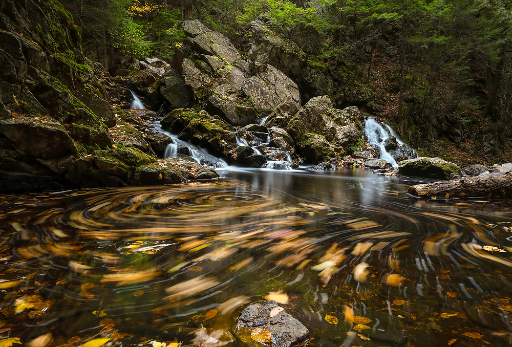 Autumn swirl at Bear's Den in New Salem, Massachusetts, Franklin County. This beautiful waterfall is tugged away in western Massachusetts not far away from Quabbin Reservoir.  It is a cascade type waterfall with a beautiful pool at the bottom of the falls surrounded by steep cliffs.    <br /> <br /> Wester Massachusetts Bear's Den waterfall photography images are available as museum quality photography prints, canvas prints, acrylic prints or metal prints. Prints may be framed and matted to the individual liking and decorating needs at:<br /> <br /> https://juergen-roth.pixels.com/featured/autumn-swirl-juergen-roth.html<br /> <br /> All high resolution New England photography images from around all six states are available for photo image licensing at www.RothGalleries.com. Please contact me direct with any questions or request. <br /> <br /> Good light and happy photo making!<br /> <br /> My best,<br /> <br /> Juergen<br /> Prints: http://www.rothgalleries.com<br /> Photo Blog: http://whereintheworldisjuergen.blogspot.com<br /> Instagram: https://www.instagram.com/rothgalleries<br /> Twitter: https://twitter.com/naturefineart<br /> Facebook: https://www.facebook.com/naturefineart
