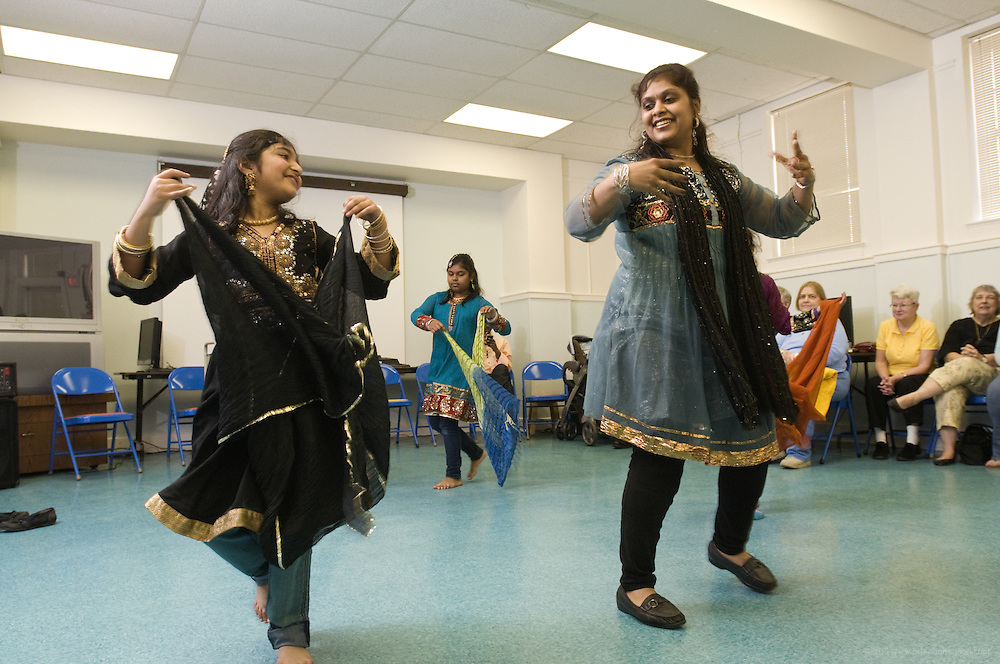 Student Preeti Tanwani, 8, left, and dancer Vindhya Katta, right, demonstrate Nachale: The Bollywood Dance Workout with Kavya Nair, 10, and Arika Diwedi, 10, and Shloka Nair, 9, during the English Conversation Club: Dance and Dialogue event Saturday April 9, 2011 at the Iroquois Branch of the Louisville Free Public Library in Louisville, Ky. Henna and Bindi followed the Bollywood dance lesson, and then volunteers were paired with English language learners to work on conversation skills. (Photo by Brian Bohannon)
