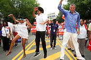 NYC mayoral candidate Bill DeBlasio,  with his  daughter Chiara left and  son Dante try out a dance move on  Eastern Parkway at the West Indian Day Parade in Brooklyn.