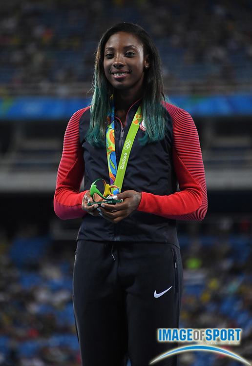 Aug 18, 2016; Rio de Janeiro, Brazil; Nia Ali (USA) poses with silver medal after placing second in the women's 100m hurdles during the 2016 Rio Olympics at Estadio Olimpico Joao Havelange.
