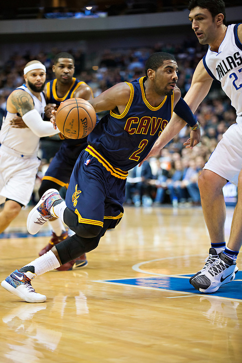 DALLAS, TX - JANUARY 12:  Kyrie Irving #2 of the Cleveland Cavaliers drives to the basket against Zaza Pachulia #27 of the Dallas Mavericks at American Airlines Center on January 12, 2016 in Dallas, Texas.  NOTE TO USER: User expressly acknowledges and agrees that, by downloading and or using this photograph, User is consenting to the terms and conditions of the Getty Images License Agreement.  The Cavaliers defeated the Mavericks 110-107.  (Photo by Wesley Hitt/Getty Images) *** Local Caption *** Kyrie Irving; Zaza Pachulia