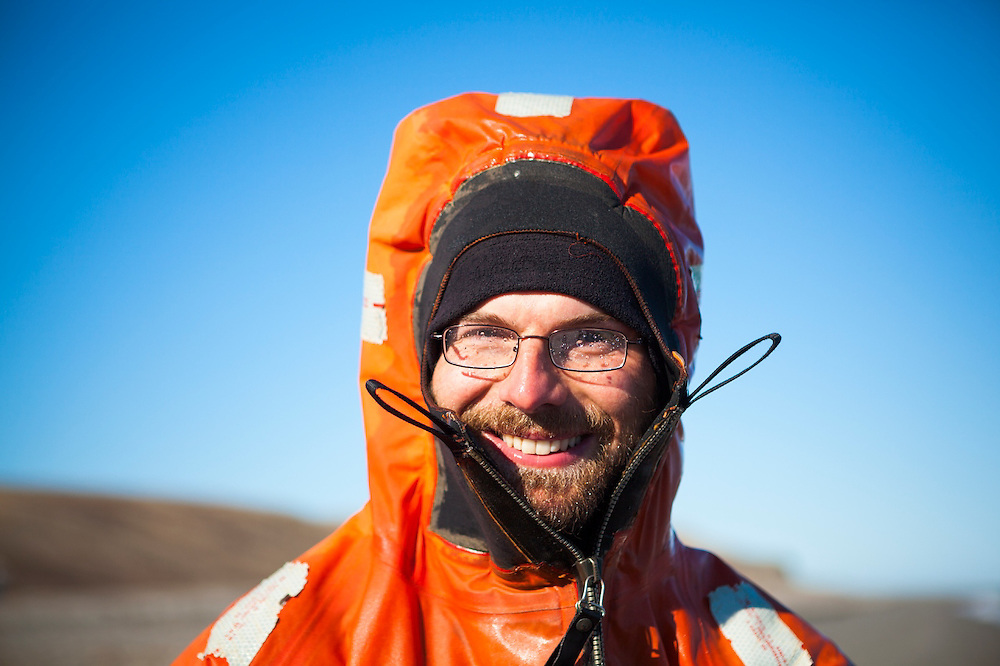 Polish geologist Lukasz Franczak wears a survival suit on the beach at the Polish field station in Calypsobyen, Svalbard.