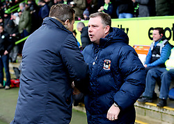 Forest Green Rovers Manager Mark Cooper (left) and Coventry City Manager Mark Robins shake hands before kick off