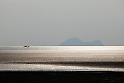A boat crossing the the bay at Santubong, Kuching, Sarawak, Malaysian Borneo
