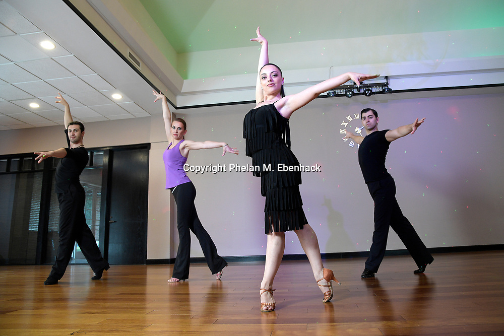 Hayk Balasanyan, left, and Emilia Poghosyan, second from right, owners of the Fred Astaire Dance Studio in Winter Park, Fla., lead a routine at their business Wednesday, Aug. 16, 2017, in Winter Park, Fla. (Photo by Phelan M. Ebenhack)