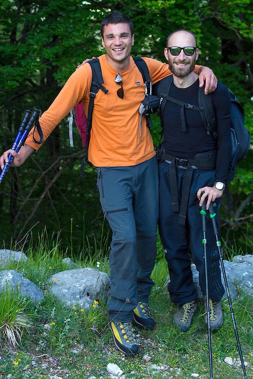 Italian hikers in the Abruzzo, Lazio e Molise National Park, in the Central Apennines rewilding area, Italy.