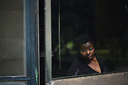 """LOWNDES COUNTY, AL – JULY 10, 2017: Steviana (Holcombe?), 43, stands at the entrance to her home, where sometimes the stench of raw sewage spilling over from the nearby lagoon is so bad that she can't go outside. """"It's like we're prisoners in our own home.""""<br /> <br /> A recent study conducted by Baylor University suggests that nearly one 1 in 3 people in Lowndes County have hookworm, a parasite normally found in poor, developing countries. Below ground septic tanks are common in Lowndes, but due to the chalky clay soil throughout much of the Black Belt, septic tanks are prone to backing up into people's homes during heavy rains. With failing or absent municipal sewage systems in the county, many families choose to live with open, above ground sewer systems made from PVC pipe, which pump raw sewage into nearby streams or open land."""
