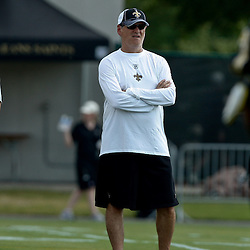 August 1, 2010; Metairie, LA, USA; New Orleans Saints general manager Mickey Loomis watches during a training camp practice at the New Orleans Saints practice facility. Mandatory Credit: Derick E. Hingle