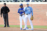 13 February 2015: Seton Hall's Derek Jenkins (6) is held on first base by North Carolina's Adrian Chacon (18). The University of North Carolina Tar Heels played the Seton Hall University Pirates in an NCAA Division I Men's baseball game at Boshamer Stadium in Chapel Hill, North Carolina. UNC won the game 7-1.