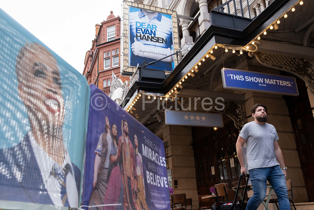 Social distance street barriers have some of many West End musical and stage play cast faces outside the Noel Coward Theatre on St. Martin's Lane in Theatreland, where the 'Dear Evan Hansen' musical is still closed to audiences during the Coronavirus pandemic, on 29th September 2020, in London, Westminster, England. Despite the government's £1.15bn financial rescue package for the Arts industry and cultural organisations in England , made up of £880m in grants and £270m of repayable loans, London's theatre industry has been hit hard by the pandemic, being closed since the March lockdown closures which has affected 137,250 Arts industry jobs, worth £21.2bn in direct turnover.