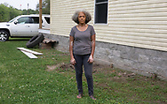 """Lydia Gerard, member of the Concerned Citiznes of St. John the Baptist next to her house in Reserve, LA.  She is very worried that the toxic emmissions from the DuPont/Denka plant and others near by make her more vulnerable to catching the coronavirus. """"There are lots of peoples I know that are being impacted. It is too many for this small area. It isn't a coincidence we have a high death rate here."""" She wants Gov. Edwards to force the petrochemical plants around them to bring down emissions, especially, the Denka plant."""