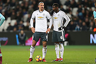 Zlatan Ibrahimovic of Manchester United (l) talks to Paul Pogba of Manchester United before taking a free kick. Premier league match, West Ham Utd v Manchester Utd at the London Stadium, Queen Elizabeth Olympic Park in London on Monday 2nd January 2017.<br /> pic by John Patrick Fletcher, Andrew Orchard sports photography.