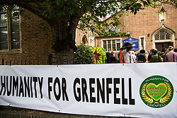 London, UK. 14th June, 2018. People listen to the Grenfell Memorial Service at St Helen's Church.