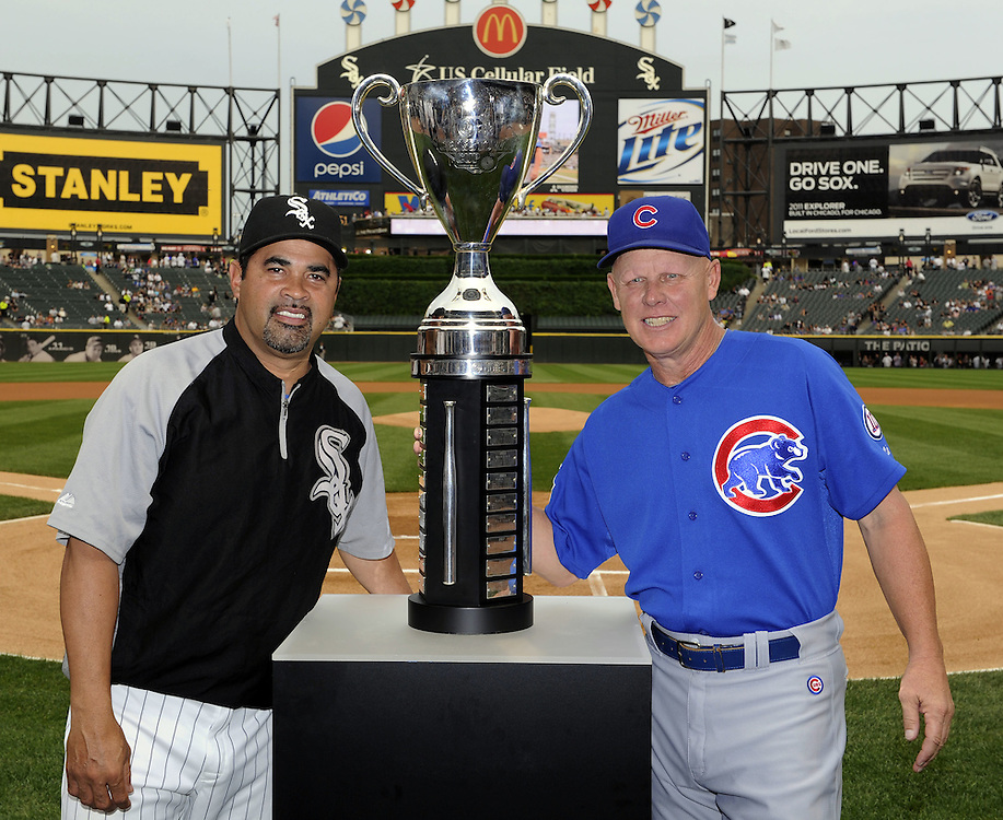 CHICAGO - JUNE 20:  Manager Mike Quade #8 of the Chicago Cubs (R) and Manager Ozzie Guillen #13 (L) of the Chicago White Sox pose with the BP Crosstown Cup prior to the game on June 20, 2011 at U.S. Cellular Field in Chicago, Illinois.  The Cubs defeated the White Sox 6-3.  (Photo by Ron Vesely)  Subject:  Mike Quade;Ozzie Guillen