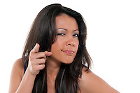 Portrait of young brunette finger pointing isolated white.