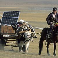 MONGOLIA, Darhad Valley, Nomadic herder pulls community's solar-powered radio telephone