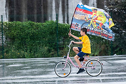 Fans from Komenda watching final stage of Tour de France cycling race, flat stage over 108 kilometers (67.11 miles) with start in Chatou and finish in Champs-Élysées on July 18, 2021 in Komenda, Slovenia. Photo by Nik Moder / Sportida